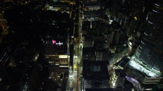 SS01_0192 - 5K stock footage aerial video fly over Nathan Road through Kowloon at night in Hong Kong, China