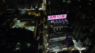 SS01_0193 - 5K stock footage aerial video fly over Nathan Road past office buildings and Kowloon Park at night in Hong Kong