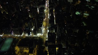 SS01_0194 - 5K stock footage aerial video of flying over Nathan Road past office buildings at Night in Kowloon, Hong Kong, China