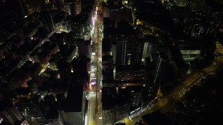 SS01_0195 - 5K stock footage aerial video of following Nathan Road past office buildings at night in Kowloon, Hong Kong, China