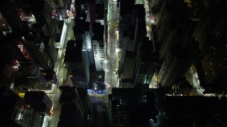 SS01_0198 - 5K stock footage aerial video approach and tilt to bird's eye of city streets and a marketplace at night in Kowloon, Hong Kong, China