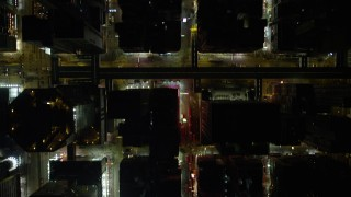 SS01_0200 - 5K stock footage aerial video of a bird's eye view of crowded city streets at night through Kowloon, Hong Kong, China