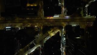 SS01_0201 - 5K stock footage aerial video bird's eye of narrow streets at night through Kowloon, Hong Kong, China