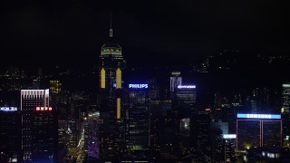 SS01_0205 - 5K stock footage aerial video approach Central Plaza and neighboring towers at night on Hong Kong Island, China