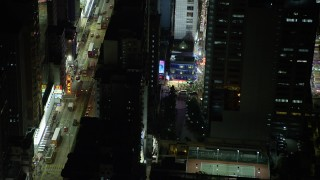 SS01_0210 - 5K stock footage aerial video slow reverse from Kowloon shop at night by busy city street in Hong Kong, China