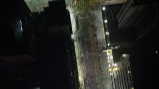 SS01_0213 - 5K stock footage aerial video a bird's eye view of pedestrians on city streets at night in Kowloon, Hong Kong, China