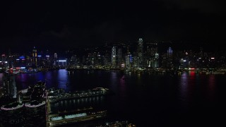 SS01_0215 - 5K stock footage aerial video approach Hong Kong Island skyline from Kowloon piers at night, China