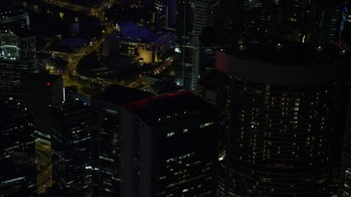 SS01_0225 - 5K stock footage aerial video of orbiting a skyscrapers at night on Hong Kong Island, China