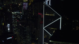 SS01_0227 - 5K stock footage aerial video orbit Bank of China Tower to reveal a pair of high-rises at night on Hong Kong Island, China