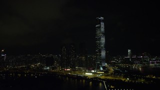 SS01_0230 - 5K stock footage aerial video of International Commerce Centre skyscraper at night in Kowloon, Hong Kong, China