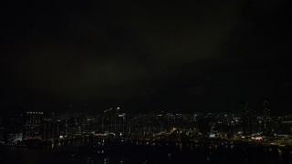 SS01_0231 - 5K stock footage aerial video of lightning flashes above Kowloon waterfront apartment buildings at night, China
