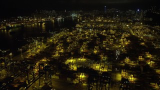 SS01_0234 - 5K stock footage aerial video fly over stacks of containers at the Port of Hong Kong at night, China