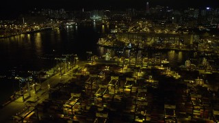 SS01_0235 - 5K stock footage aerial video fly over rows of shipping containers at night at the Port of Hong Kong, China