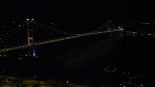 SS01_0241 - 5K stock footage aerial video approach Tsing Ma Bridge at night in Hong Kong, China