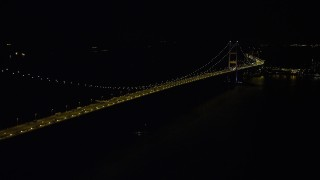 SS01_0242 - 5K stock footage aerial video approach the center of the Tsing Ma Bridge at night in Hong Kong, China