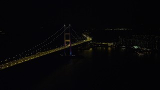 SS01_0244 - 5K stock footage aerial video of passing part of the Tsing Ma Bridge at night in Hong Kong, China