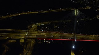 SS01_0248 - 5K stock footage aerial video flyby light traffic on the Ting Kau Bridge at night in Hong Kong, China