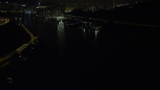 SS01_0249 - 5K stock footage aerial video flyby Ting Kau Bridge at night and tilt to reveal piers on the Rambler Channel in Hong Kong, China