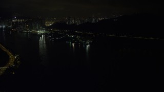 SS01_0250 - 5K stock footage aerial video approach small piers and warehouses on Rambler Channel at night in Hong Kong, China