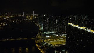 SS01_0257 - 5K stock footage aerial video of tall apartment complexes by the channel at night on Tsing Yi Island, Hong Kong, China