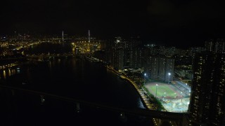 SS01_0258 - 5K stock footage aerial video approach Stonecutters Bridge from waterfront apartment complexes on Tsing Yi Island at night, China