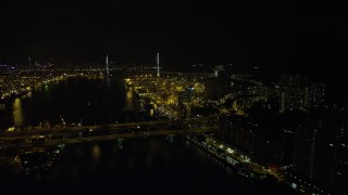 SS01_0260 - 5K stock footage aerial video fly over Rambler Channel at night to approach Stonecutters Bridge and Port of Hong Kong, China