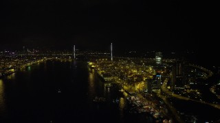 SS01_0261 - 5K stock footage aerial video follow Rambler Channel by the Port to Hong Kong at night to approach Stonecutters Bridge, China