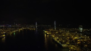 SS01_0262 - 5K stock footage aerial video flyby Port of Hong Kong at night to approach Stonecutters Bridge, China