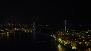 SS01_0264 - 5K stock footage aerial video approach the Stonecutters Bridge at night from Rambler Channel in Hong Kong, China