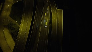 SS01_0270 - 5K stock footage aerial video bird's eye view of cars and trucks on a freeway at night on Lantau Island, Hong Kong, China