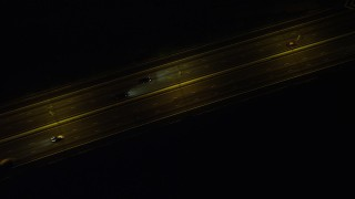 SS01_0271 - 5K stock footage aerial video bird's eye view of freeway traffic on Lantau Island at night in Hong Kong, China