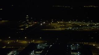 SS01_0277 - 5K stock footage aerial video pan across Hong Kong International Airport at night, China