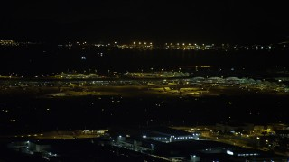 SS01_0278 - 5K stock footage aerial video of airliners and terminals at the Hong Kong International Airport at night, China
