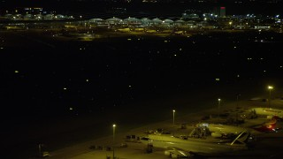 SS01_0281 - 5K stock footage video of airliners parked near taxiway at night at the Hong Kong International Airport, China
