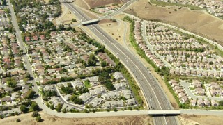 TS01_003 - 1080 stock footage aerial video of a bird's eye view of 118 freeway and homes in Simi Valley, California