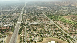 TS01_004 - 1080 stock footage aerial video tilt from 118 freeway to wide view of Simi Valley, California