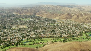 TS01_005 - 1080 stock footage aerial video fly over golf course and homes in Simi Valley, California