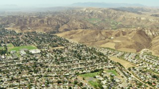 TS01_006 - 1080 stock footage aerial video fly over homes toward hills in Simi Valley, California