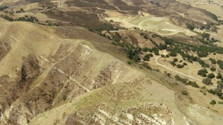 TS01_010 - 1080 stock footage aerial video tilt from bird's eye view of hills in Simi Valley, California