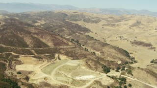 TS01_011 - 1080 stock footage aerial video of flying over barren hills and valleys in Simi Valley, California