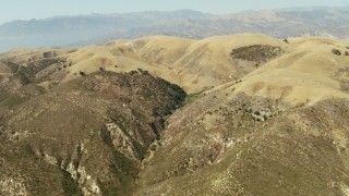 TS01_012 - 1080 stock footage aerial video approach and fly over brown hills in Simi Valley, California