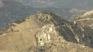 TS01_017 - 1080 stock footage aerial video of a mountain summit and road in Los Padres National Forest, California