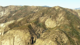 TS01_026 - 1080 stock footage aerial video tilt to a view of a mountain ridge summit in Los Padres National Forest, California