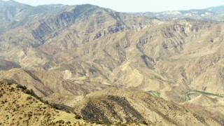 TS01_028 - 1080 stock footage aerial video of flying over a ridge toward more mountains, Los Padres National Forest, California