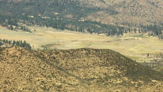 TS01_029 - Aerial stock footage of 1080 aerial  video of hills, valley, and evergreens in Los Padres National Forest, California