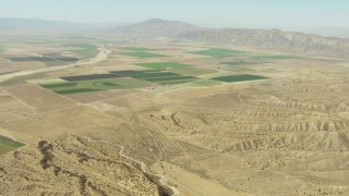 TS01_036 - 1080 stock footage aerial video approach farm fields in Cuyama Valley, California