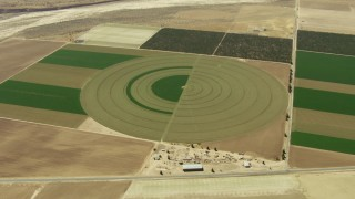 TS01_037 - 1080 stock footage aerial video of circular crop field in Cuyama Valley, California