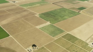 TS01_038 - 1080 stock footage aerial video of farmhouses and farmland in Cuyama Valley, California