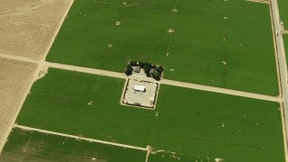 TS01_040 - 1080 stock footage aerial video of a bird's eye of farmhouse and fields, Cuyama Valley, California