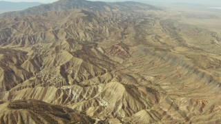 TS01_046 - 1080 stock footage aerial video tilt from mountains to a wide view of the Caliente Mountain Range, California